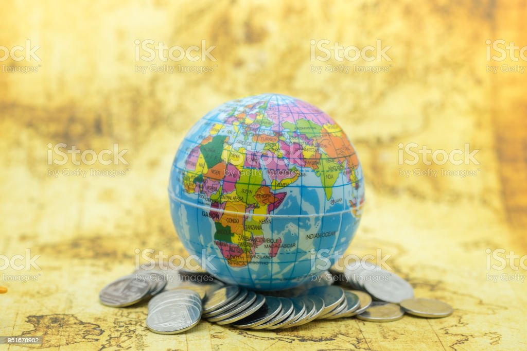 Mini World Map.Global Business Concept Mini World Ball On Pile Of Silver Coin With