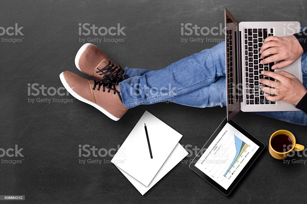 Global business growth graph analyzing with laptop stock photo