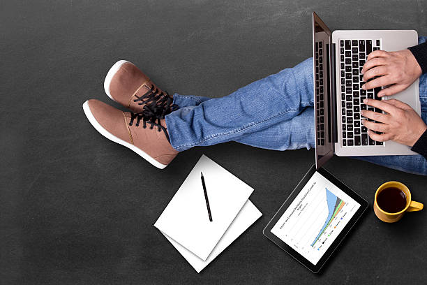 global business growth graph analyzing with laptop - sitting on floor stock photos and pictures
