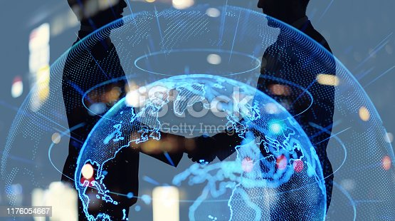Global business network concept. Business person shaking hands.