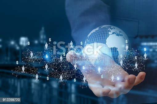 istock Global business network in hand . 912259720