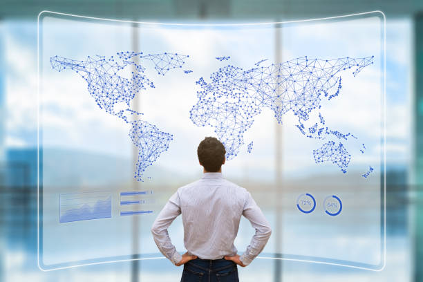 Global business network with connected lines on world map, worldwide data telecommunication for internet of things, fintech, and blockchain technology, concept with businessman analyzing dashboard stock photo