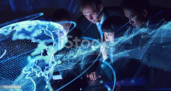 913589004istockphoto Global communication concept. Group of engineer and futuristic GUI. 1004013194