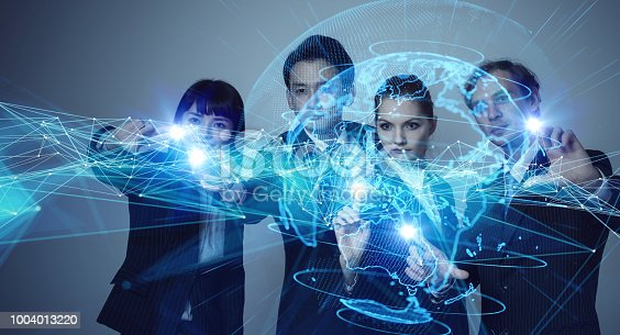 913589004istockphoto Global communication concept. Group of engineer and futuristic GUI. 1004013220