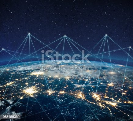 878855462istockphoto Global communication technology and telecommunication financial network around planet Earth. Blockchain and cryptocurrency concept with copyspace. IOT. Elements of this photo furnished by NASA. 963459052