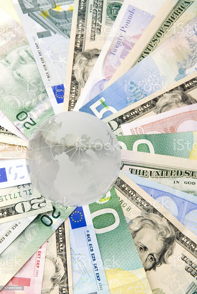 Global currencies, concept with globe - II royalty-free stock photo