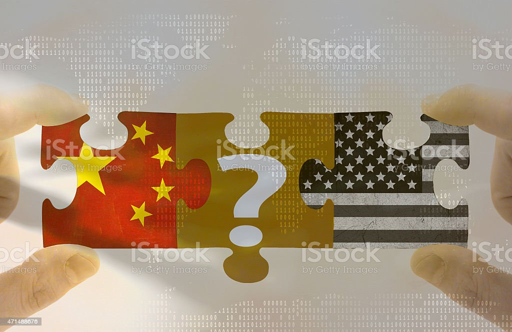 Global economic prospects The Group of Two (G2) foreign policy. Grungy old flags of China and USA puzzle concept 2015 Stock Photo