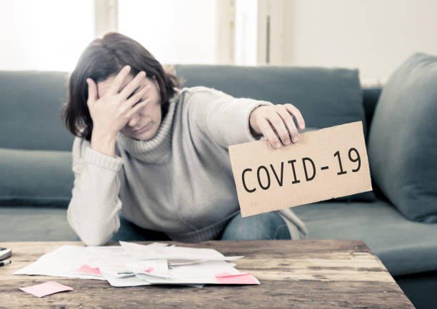 COVID-19 Global economic Recession. Depressed woman desperate not able to pay rent and expenses. Worker affected by global economic recession amid to Coronavirus job losses and financial impact. COVID-19 Global economic Recession. Depressed woman desperate not able to pay rent and expenses. Worker affected by global economic recession amid to Coronavirus job losses and financial impact. amid stock pictures, royalty-free photos & images