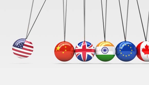 weltwirtschaft internationale flaggen wiege - britische politik stock-fotos und bilder
