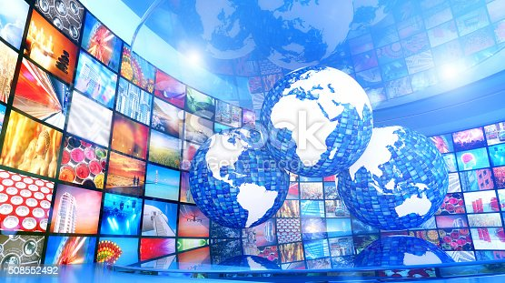 451823313 istock photo Global enterntainment: world map surrounded by television videos 508552492