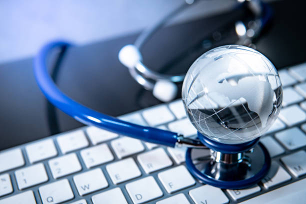 Global healthcare concept. World globe crystal glass on blue stethoscope on white keyboard. Health and medical science. Worldwide wellness business and technology Global healthcare concept. World globe crystal glass on blue stethoscope on white keyboard. Health and medical science. Worldwide wellness business and technology world health day stock pictures, royalty-free photos & images