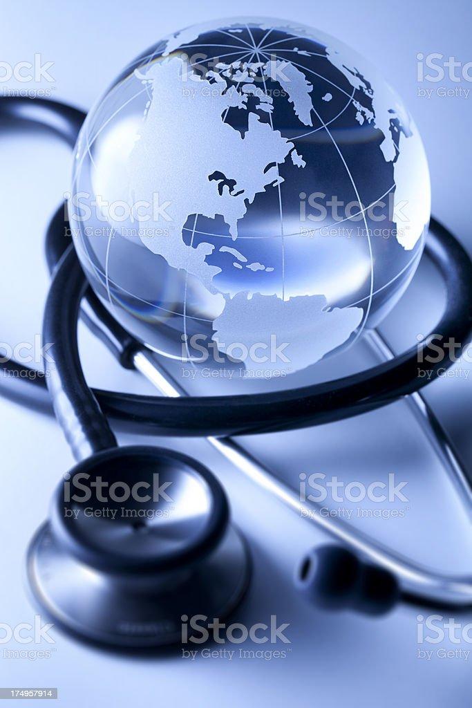 Global healthcare. Globe and stethoscope. stock photo
