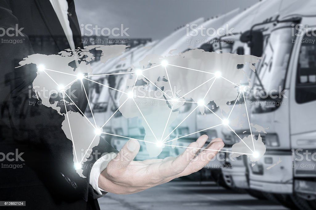 Global logistics network map on hand of businessman. stock photo