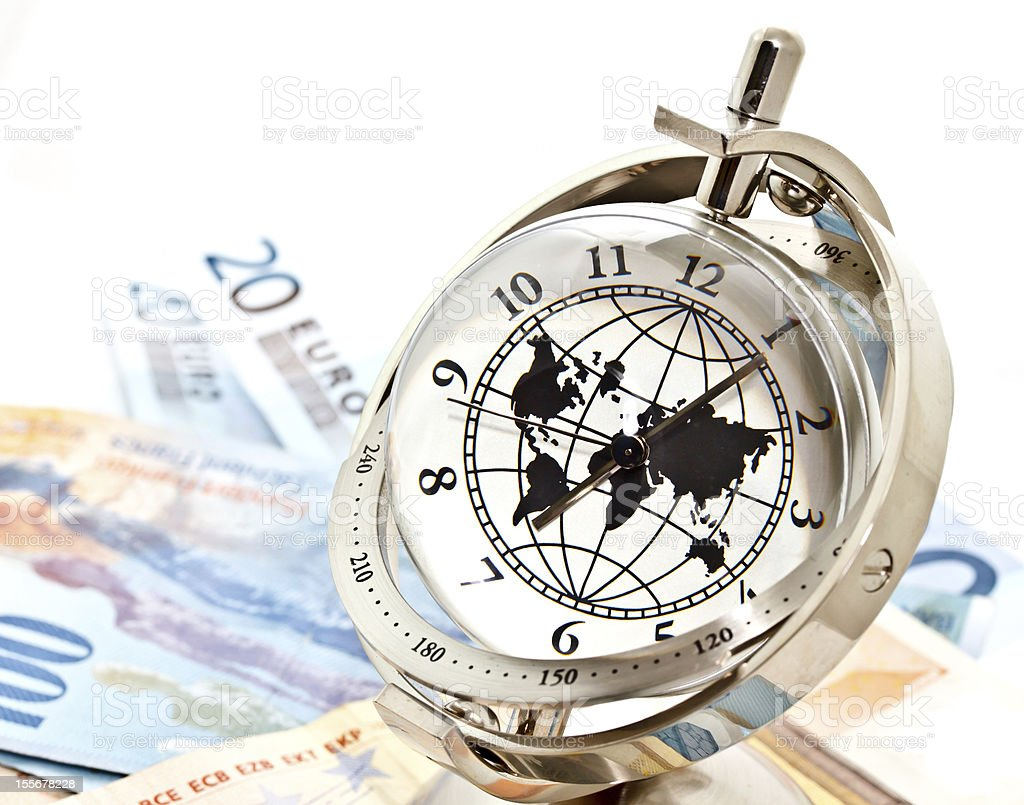 global model clock placed on banknotes royalty-free stock photo