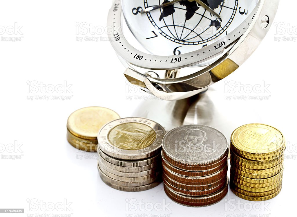 global model clock with towers of coins royalty-free stock photo