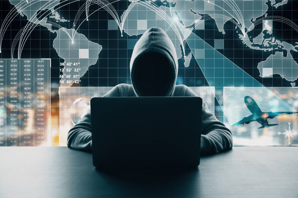 Global network and travel concept Hacker at desktop using laptop with abstract digital map interface on blurry background. Global network and travel concept. Multiexposure computer crime stock pictures, royalty-free photos & images