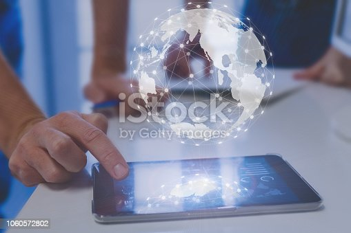 1019729218 istock photo Global network connection around digital globe, internet of things (IoT) concept, worldwide finance technology (fintech), international communication, business people using digital tablet 1060572802