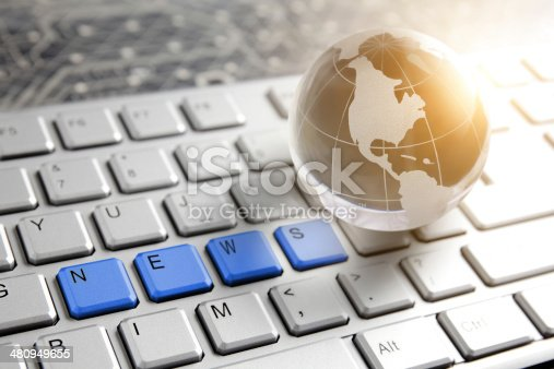 Global News, glass Globe and Computer Keyboard with NEWS text