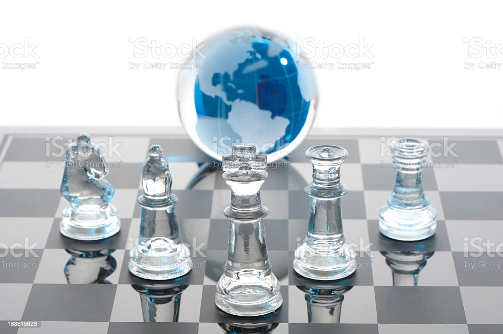 Global strategy concept with glass chess set royalty-free stock photo