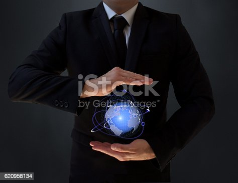 World is small. Businessman holding world in hands. New generation communication technology and global network. The future of social media.