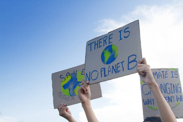 Global warming and climate change concept. Group people of demonstration making protest about climate change, plastic pollution and forest fire for environmental problem social justice concept stock pictures, royalty-free photos & images