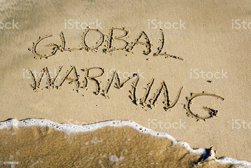 Global Warming, Climate Change Message Written in Sand by Sea royalty-free stock photo
