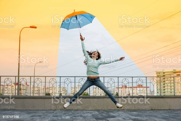 Global warming girl holding an umbrella is in a comfortable climate picture id915741156?b=1&k=6&m=915741156&s=612x612&h=k ms 3edk30iaoxhgpyrmqmbn2amqpox3hbpyicwyhk=
