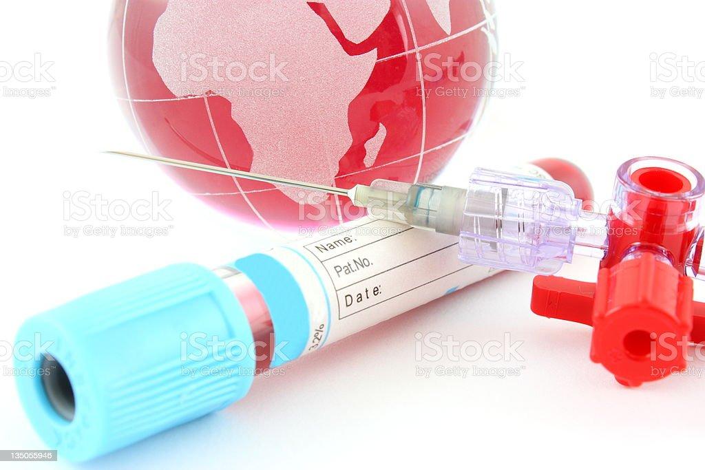 Globe and blood serum stock photo