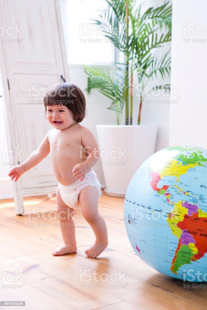 Globe and diaper girls stock photo