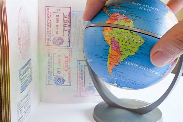 Globe and passport stock photo
