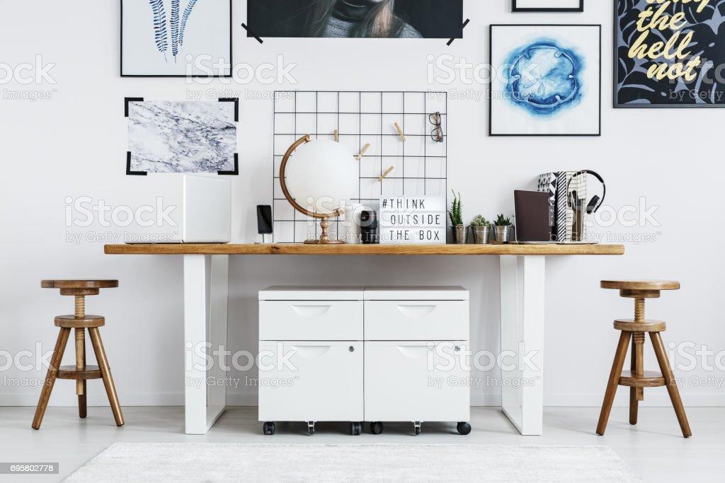 Globe and plants on desk stock photo