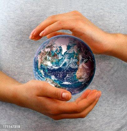 638813890istockphoto Globe between hands 171147319