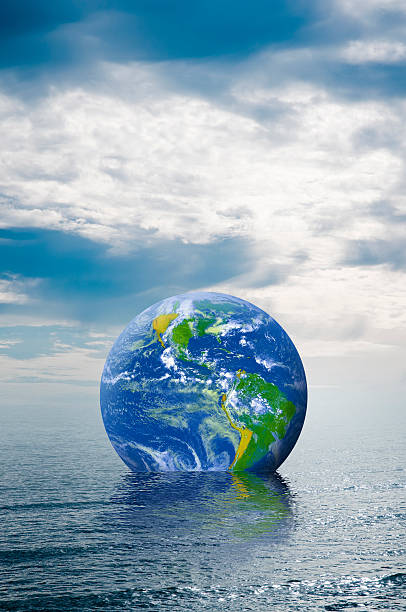 Globe floating in the ocean stock photo