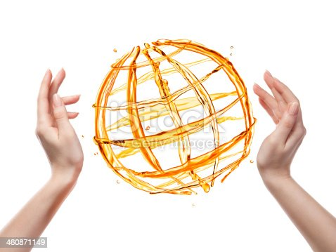 858282944istockphoto Globe from orange water with human hand isolated on white 460871149