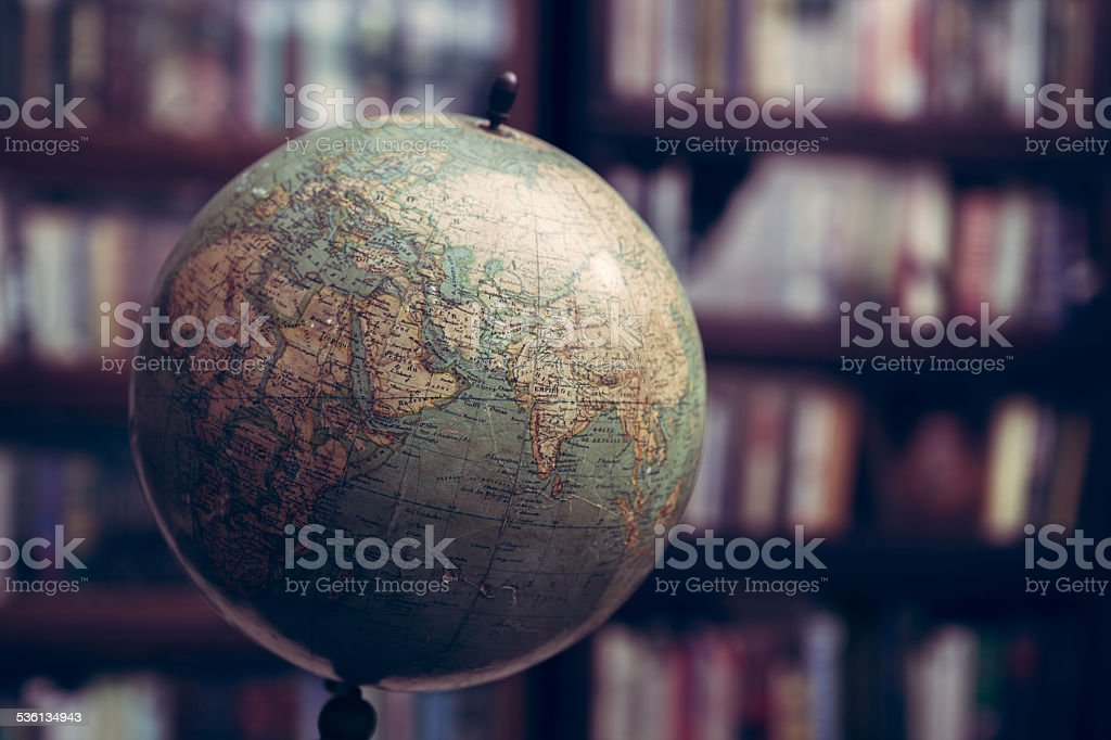 Globe in a library stock photo
