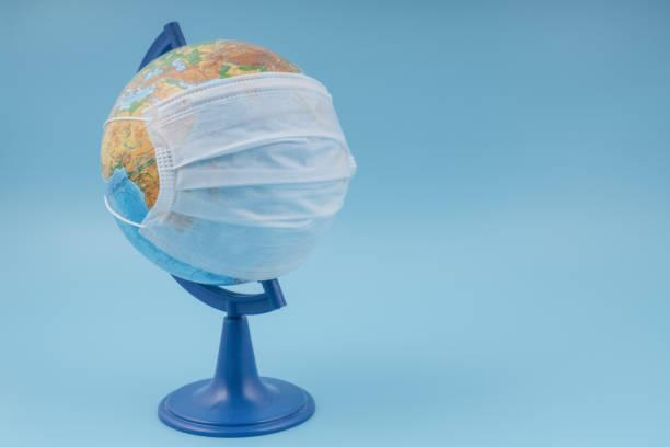 Globe in a medical mask. Concept epidemic, coronavirus, infection stock photo