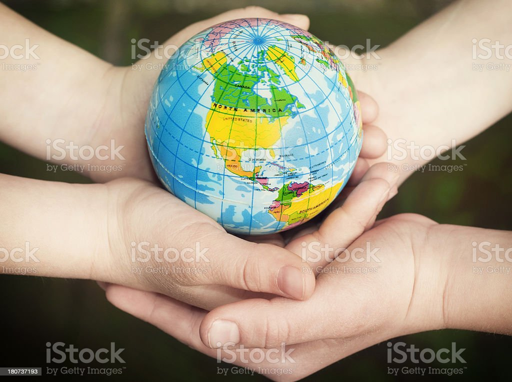 Globe in children's hands. royalty-free stock photo