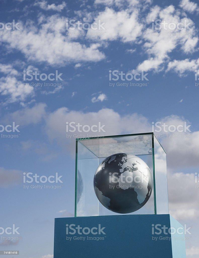 Globe in glass box on pedestal royalty-free stock photo