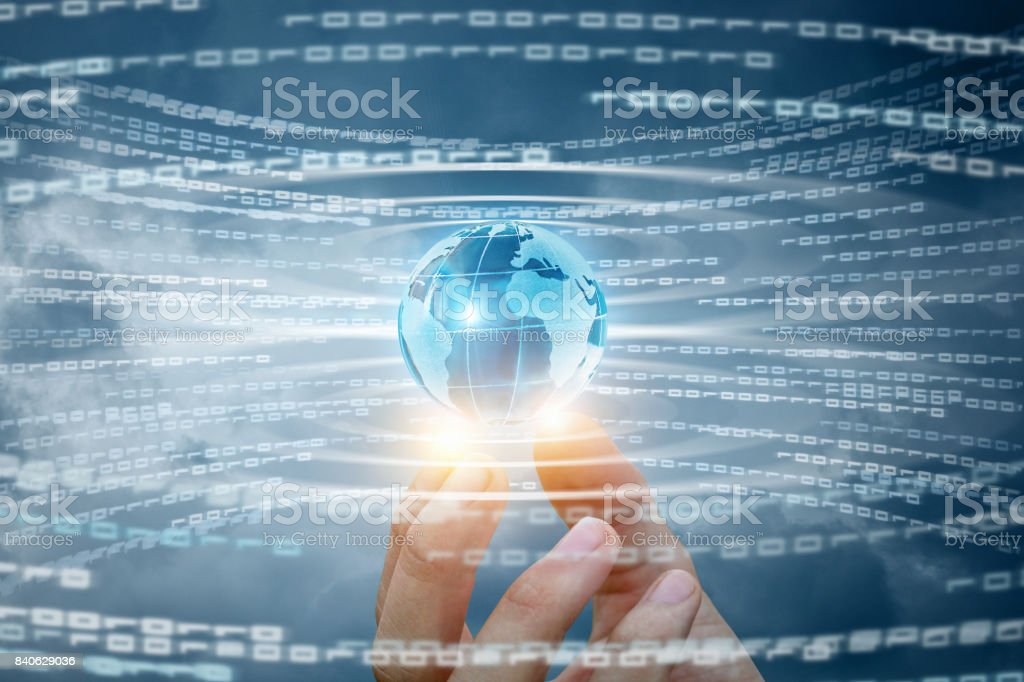 Globe in hand on the background of the flow of information. stock photo