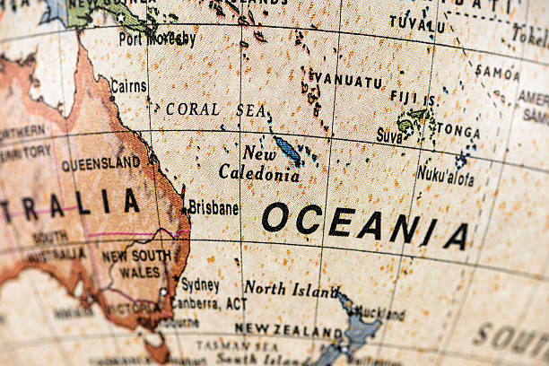 Globe Oceania Close-up of New Caledonia in the colorful world map. vanuatu stock pictures, royalty-free photos & images