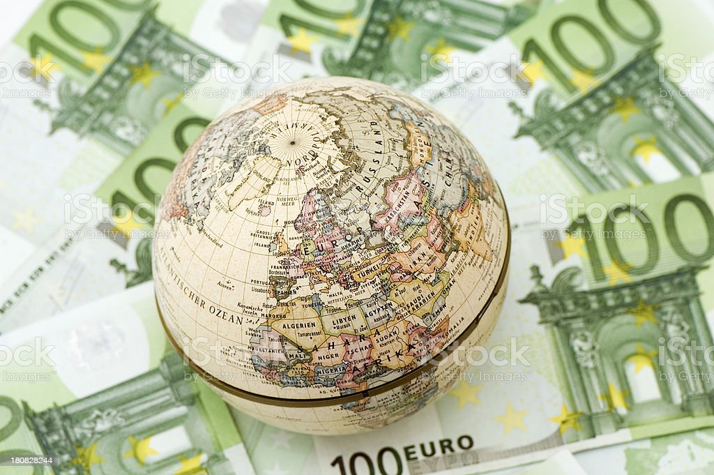 Globe on 100 euro banknote background. royalty-free stock photo