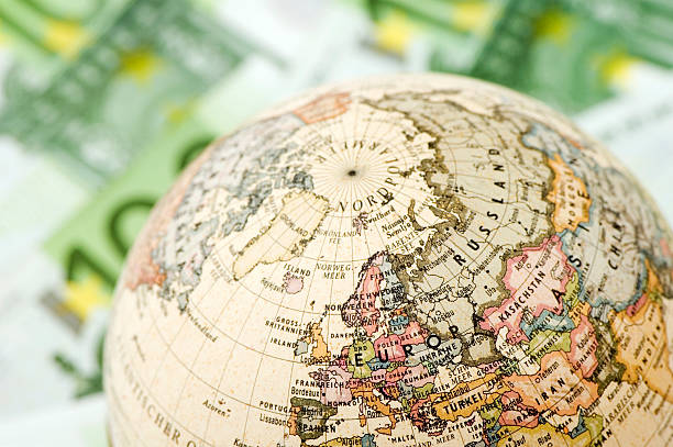 Globe on 100 euro banknote background.