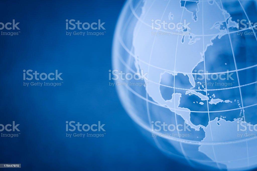 Globe on blue background royalty-free stock photo