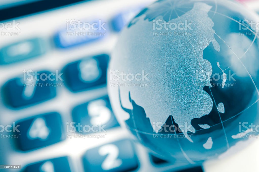 Globe on calculator, asia map royalty-free stock photo