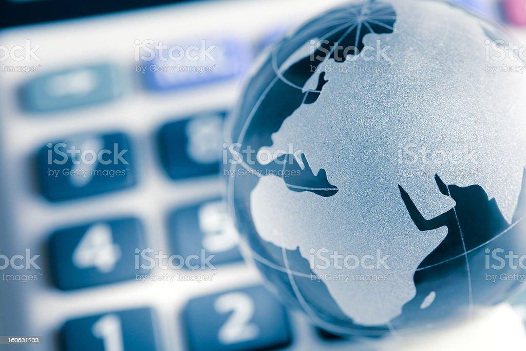 Globe on calculator, Europe map royalty-free stock photo
