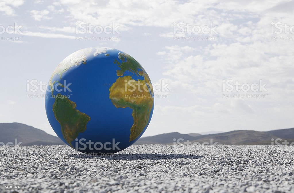 Globe on gravel outdoors royalty-free stock photo