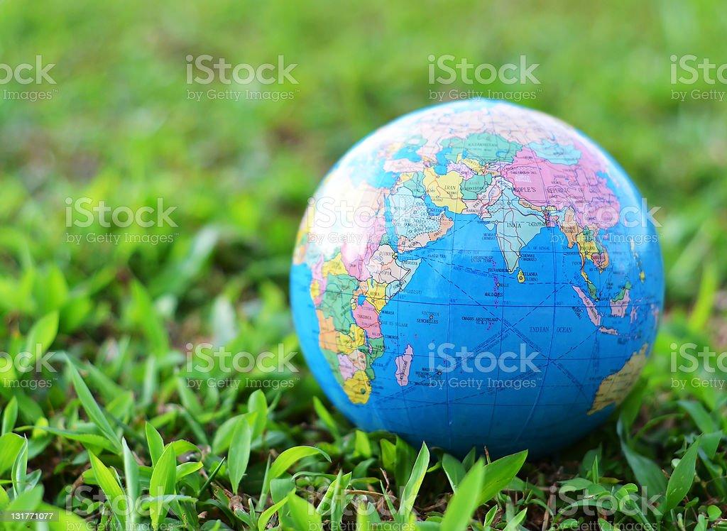 Globe on green grass stock photo