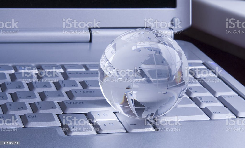 Globe on keyboard of  modern notebook royalty-free stock photo