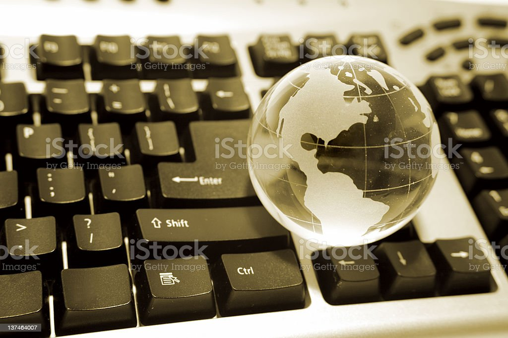 Globe on keyboard royalty-free stock photo