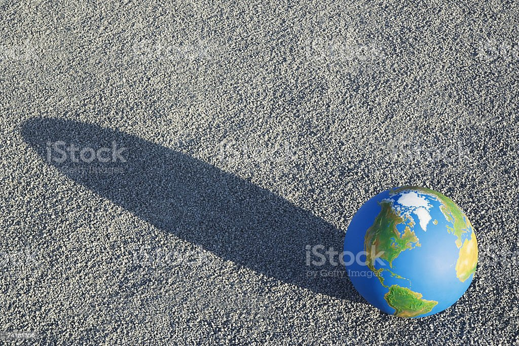 Globe on sand outdoors royalty-free stock photo